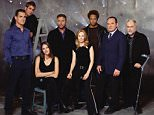 LOS ANGELES - NOVEMBER 4:  The cast of CSI: CRIME SCENE INVESTIGATION.  from left: George Eads (blue shirt), Eric Szmanda, Jorja Fox, William Petersen, Marg Helgenberger, Gary Dourdan, Paul Guilfoyle, Robert David Hall.  Image dated November 4, 2003.  (Photo by Andrew Southam/CBS Photo Archive via Getty Images)