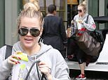 Khloe Kardashian visits sister Kendall Jenner after an early morning workout session in Beverly Hills.  May 12, 2015 X17online.com