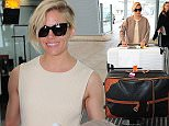 12 May 2015 - LONDON - UK  SIENNA MILLER AT HEATHROW AIRPORT  BYLINE MUST READ : XPOSUREPHOTOS.COM  ***UK CLIENTS - PICTURES CONTAINING CHILDREN PLEASE PIXELATE FACE PRIOR TO PUBLICATION ***  **UK CLIENTS MUST CALL PRIOR TO TV OR ONLINE USAGE PLEASE TELEPHONE   44 208 344 2007 **