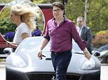 12.MAY.2015  - LONDON  - UK *** EXCLUSIVE ALL ROUND PICTURES *** ENGLISH COMEDIAN MICHAEL MCINTYRE AND HIS WIFE KITTY MCINTYRE WERE SEEN PARKING UP IN THEIR MATTE BLACK FERRARI AT THE PAY AND DISPLAY SPOT BEFORE HEADING INTO THE FASHIONABLE HIGH END JAPANESE RESTAURANT NOBU IN MAYFAIR LONDON. BYLINE MUST READ : XPOSUREPHOTOS.COM ***UK CLIENTS - PICTURES CONTAINING CHILDREN PLEASE PIXELATE FACE PRIOR TO PUBLICATION *** **UK CLIENTS MUST CALL PRIOR TO TV OR ONLINE USAGE PLEASE TELEPHONE  442083442007