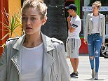 UK CLIENTS MUST CREDIT: AKM-GSI ONLY EXCLUSIVE: Gigi Hadid and Joe Jonas arrive for lunch at Cheebo Restaurant in the WeHo area. The famous pair have been friends for years, but that's how relationships start right? Hadid stopped by a local gas station in her Range Rover, while Jonas joined a friend and ran a few errands before returning home.  Pictured: Gigi Hadid and Joe Jonas Ref: SPL1025167  130515   EXCLUSIVE Picture by: AKM-GSI / Splash News