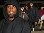 Kanye West was spotted arriving at LAX, with his hood up, in no mood to chat with fans, on Thursday, May 14, 2015  X17online.com