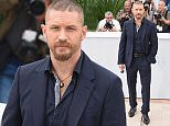 """CANNES, FRANCE - MAY 14:  Tom Hardy attends the """"Mad Max : Fury Road""""  Photocall during the 68th annual Cannes Film Festival on May 14, 2015 in Cannes, France.  (Photo by Venturelli/WireImage)"""