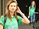 12.MAY.2015 - LOS ANGELES -  USA ***AVAILABLE FOR UK SALE ONLY *** **EXCLUSIVE ALL ROUND PICTURES** A FRESH FACED BEHATI PRINSLOO ARRIVES AT LAX FROM A LATE FLIGHT IN.  THE VICTORIA'S SECRET CUTIE GAVE A FRIENDLY PEACE SIGN AND A BIG SMILE DESPITE APPEARING TO BE A BIT JET LAGGED WEARING A COOL CALIFORNIA GRAPHIC TEE AND HER CELL PHONE STUCK IN THE FRONT OF HER JEANS. BYLINE MUST READ: XPOSUREPHOTOS.COM ***UK CLIENTS - PICTURES CONTAINING CHILDREN PLEASE PIXELATE FACE PRIOR TO PUBLICATION *** *UK CLIENTS MUST CALL PRIOR TO TV OR ONLINE USAGE PLEASE TELEPHONE 0208 344 2007*