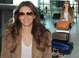 Liz Hurley pushes a trolley through Heathrow Airport departures on her way to catching a flight to the USA\n\nPictured: Liz Hurley\nRef: SPL1023601  130515  \nPicture by: Splash News\n\nSplash News and Pictures\nLos Angeles: 310-821-2666\nNew York: 212-619-2666\nLondon: 870-934-2666\nphotodesk@splashnews.com\n