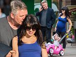 Picture Shows: Alec Baldwin, Carmen Baldwin, Hilaria Thomas  May 12, 2015\n \n Actor Alec Baldwin and his pregnant wife Hilaria Thomas enjoy a day of quality family time with their daughter Carmen at Washington Square Park in New York City, New York. At one point during the outing Alec stopped to share some PDA with his expecting wife. \n \n Non Exclusive\n UK RIGHTS ONLY\n \n Pictures by : FameFlynet UK � 2015\n Tel : +44 (0)20 3551 5049\n Email : info@fameflynet.uk.com