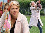 Picture Shows: Kate Upton  May 12, 2015    Actress Kate Upton and Matt Barr toss around a football during their break on the set of 'The Layover' in Vancouver, Canada. Kate was pretty good at throwing the football but not so good at catching the football.     Non Exclusive  UK RIGHTS ONLY    Pictures by : FameFlynet UK � 2015  Tel : +44 (0)20 3551 5049  Email : info@fameflynet.uk.com