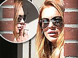 Lindsay Lohan on a smoke break while serving community service hours at a daycare in Brooklyn on May 14th, 2015\n