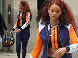 UK CLIENTS MUST CREDIT: AKM-GSI ONLY\nEXCLUSIVE: After inspiring memes on the internet while attending the Met Gala wearing a very unique yellow gown this past Monday, Rihanna and her girlfriends are seen here exiting her NYC aparment this afternoon, wearing once again, a unique colored outfit, ahead of a shopping trip.\n\nPictured: Rihanna\nRef: SPL1025386  130515   EXCLUSIVE\nPicture by: AKM-GSI / Splash News\n\n