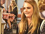 13.MAY.2015 - CANNES - FRANCE  *EXCLUSIVE ALL ROUND PICTURES* * STRICTLY NOT AVAILABLE FOR ITALY * BRITISH MODEL CARA DELEVINGNE SEEN ENJOYING DINNER WITH FRIENDS INCLUDING AMERICAN ACTRESS ZOE KRAVITZ AT AN ITALIAN RESTAURANT DURING THE 68TH ANNUAL CANNES FILM FESTIVAL. BYLINE MUST READ : XPOSUREPHOTOS.COM ***UK CLIENTS - PICTURES CONTAINING CHILDREN PLEASE PIXELATE FACE PRIOR TO PUBLICATION *** **UK CLIENTS MUST CALL PRIOR TO TV OR ONLINE USAGE PLEASE TELEPHONE 0208 344 2007**