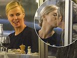 13.MAY.2015 - CANNES - FRANCE  *** EXCLUSIVE ALL ROUND PICTURES AVAILABLE FOR UK SALE ONLY *** SEAN PENN AND CHARLIZE THERON ENJOY A MEAL TOGETHER AT TETOU RESTAURANT IN GOLFE JUAN DURING THE 68TH ANNUAL CANNES FILM FESTIVAL. THE COUPLE WERE SEEN SHARING A KISS AND WAVING OUT OF THE WINDOW TO THEIR SON JACKSON PLAYING ON THE BEACH ACCOMPANIED BY A NANNY. BYLINE MUST READ : XPOSUREPHOTOS.COM ***UK CLIENTS - PICTURES CONTAINING CHILDREN PLEASE PIXELATE FACE PRIOR TO PUBLICATION *** **UK CLIENTS MUST CALL PRIOR TO TV OR ONLINE USAGE PLEASE TELEPHONE 0208 344 2007**