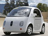 In this May 13, 2015 photo, Google's new self-driving prototype car drives around a parking lot during a demonstration at Google campus in Mountain View, Calif.  The car, which needs no gas pedal or steering wheel, will make its debut on public roads this summer. (AP Photo/Tony Avelar)