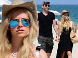 Picture Shows: Chad Kroeger, Avril Lavigne  May 11, 2015\n \n Singer Avril Lavigne enjoys a romantic stroll on the beach with her husband Chad Kroeger in Miami, Florida.\n \n Avril, who's recovering from Lyme Disease, looked a bit overdressed for the beach, wearing a black dress and Uggs as the couple walked hand-in-hand along the sand.\n \n Exclusive All Rounder\n UK RIGHTS ONLY\n Pictures by : FameFlynet UK © 2015\n Tel : +44 (0)20 3551 5049\n Email : info@fameflynet.uk.com