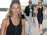 CANNES, FRANCE - MAY 14:  Model Karlie Kloss is seen at the Nice airport during the 68th annual Cannes Film Festival on May 14, 2015 in Cannes, France.  (Photo by Marc Piasecki/GC Images)