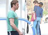 Gerard Butler gets a kiss on his neck while pumping gas in Malibu.\n\nPictured: Gerard Butler\nRef: SPL1024156  130515  \nPicture by: Reefshots / Splash News\n\nSplash News and Pictures\nLos Angeles: 310-821-2666\nNew York: 212-619-2666\nLondon: 870-934-2666\nphotodesk@splashnews.com\n