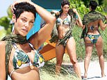 Nicole Murphy spotted having a photo shoot on the beach in Miami. Nicole was looking fit as she posed in a beautiful green bikini on a lifeguard stand and in the ocean.\n\nPictured: Nicole Murphy\nRef: SPL1025314  140515  \nPicture by: Jason Winslow / Splash News\n\nSplash News and Pictures\nLos Angeles: 310-821-2666\nNew York: 212-619-2666\nLondon: 870-934-2666\nphotodesk@splashnews.com\n