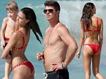 Picture Shows: Robin Thicke, Julian Thicke  May 06, 2015\n \n *** Min Web / Online Fee £150 For Set ***\n \n Thirty-eight year-old 'Blurred Lines' singer Robin Ticke enjoys a sun filled vacation with his twenty year-old girlfriend, model April Love Geary; and his cute son Julian in St Barts. \n \n The group cooled off in the ocean and went for a bit of snorkeling - afterwards, Robin dropped his sunglasses while playing with his son but after a bit of searching was able to find them. The hot new couple recently caused a bit of a stir on their way to the Caribbean, as travelers complained about Robin blocking people as they boarded because he was standing in the aisle; leaning over to make out with April in her seat.\n \n *** Min Web / Online Fee £150 For Set ***\n \n Exclusive All Rounder\n UK RIGHTS ONLY\n Pictures by : FameFlynet UK © 2015\n Tel : +44 (0)20 3551 5049\n Email : info@fameflynet.uk.com