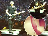 """PIC BY GEOFF ROBINSON PHOTOGRAPHY 07976 880732.\n Pic shows The Edge from U2 falling off the edge of the stage last night  (May 14) in  Vancouver, Canada, on the first night of the bands new tour.\nU2's guitarist The Edge fell off the EDGE of the stage during the debut show of their new tour last night (Thurs).\nDavid Evans, who is better known as The Edge, fell off the band's walkway stage on the opening night of the rock band's Innocence and Experience Tour in Vancouver, Canada.\nThe 53-year-old rock star was performing their hit song I Still Haven't Found What I'm Looking For at the end of the show at the Rogers Arena.\nFans looked on concerned as he missed his footing and fell into the crowd, where security guards quickly helped him, whilst the rest of the band continued singing the hit song.\nThe Edge later tweeted a photo of himself showing a nasty graze on his right arm and holding a glass of beer.\nHe wrote: """"Didn't see the edge. I'm ok!!""""\nSEE COPY CATCHLINE U2 The Edge falls"""
