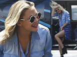 EXCLUSIVE: Kate Hudson, accompanied by an assistant and an unidentified male companion, almost suffers a wardrobe malfunction while getting off a helicopter after arriving in New York City.\n\nPictured: Kate Hudson\nRef: SPL1026623  150515   EXCLUSIVE\nPicture by: Splash News\n\nSplash News and Pictures\nLos Angeles: 310-821-2666\nNew York: 212-619-2666\nLondon: 870-934-2666\nphotodesk@splashnews.com\n
