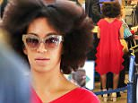 Please contact X17 before any use of these exclusive photos - x17@x17agency.com   PREMIUM EXCLUSIVE - Solange Knowles was hard to miss at LAX.  The sister of pop icon, Beyonce, Solange was wearing a bright red dress, with her hair looking wild on her way to New York, on Friday, May 15, 2015  X17online.com