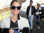16 May 2015 - CANNES  - FRANCE   CHERYL FERNANDEZ VERSINI AND HUSBAND JEAN BERNARD PICTURED LEAVING CANNES FILM FESTIVAL WALKING THROUGH NICE AIRPORT   BYLINE MUST READ : XPOSUREPHOTOS.COM  ***UK CLIENTS - PICTURES CONTAINING CHILDREN PLEASE PIXELATE FACE PRIOR TO PUBLICATION ***  **UK CLIENTS MUST CALL PRIOR TO TV OR ONLINE USAGE PLEASE TELEPHONE   44 208 344 2007 **