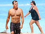 EXCLUSIVE: ** PREMIUM RATES APPLY** A shirtless Pierce Brosnan stays in shape by running the beach and then snorkeling while in Hawaii.\n\nPictured: Pierce Brosnan\nRef: SPL1020643  140515   EXCLUSIVE\nPicture by: Splash News\n\nSplash News and Pictures\nLos Angeles: 310-821-2666\nNew York: 212-619-2666\nLondon: 870-934-2666\nphotodesk@splashnews.com\n