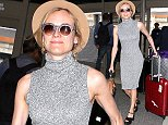 Diane Kruger was spotted wearing a form fitting dress, with a hat and shades, for a bit of air travel.  The actress was on her way to Paris, France, on Thursday, May 14, 2015  X17online.com\nEXCLUSIVE\nOK FOR WEB SITE USAGE AT £30 PER IMAGE USED.\nAny quieries please call Alasdair or Gary on office 0034 966 713 949/926 or mibile Gary 0034 686 421 720 or Alasdair on 0034 630 576 519