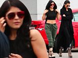Please contact X17 before any use of these exclusive photos - x17@x17agency.com   Fashionista Kendall and Kylie having fun at private jet airport sunday takingpictures , Kendall showing off her boots May 17, 2015 X17online.com