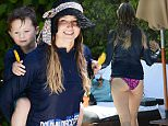 ***MANDATORY BYLINE TO READ INFPhoto.com ONLY***\nAlaskan singer Jewel and her son Kase stay covered up to avoid too much sun by the pool in Miami Beach.\n\nPictured: Jewel\nRef: SPL1028017  160515  \nPicture by: INFphoto.com\n\n