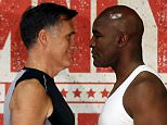 Former Massachusetts Governor and two-time presidential candidate Mitt Romney (L) and five-time heavyweight champion Evander Holyfield stare down during their weigh-in before their boxing match in Holladay, Utah May 14, 2015. The two will box on Friday to benefit the medical charity CharityVision. REUTERS/Jim Urquhart