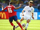 Cristian Gamboa of Costa Rica challenges Luke Shaw of England during the 2014 FIFA World Cup Brazil Group D match between Costa Rica and England at Estadio Mineirao in Belo Horizonte, Brazil.     BELO HORIZONTE, BRAZIL - JUNE 24:  (Photo by Richard Heathcote/Getty Images)