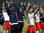 The PSG squad salute their travelling fans after beating Montpellier 2-1 away from home