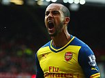 MANCHESTER, ENGLAND - MAY 17:  Theo Walcott of Arsenal celebrates as his cross deflects of off Tyler Blackett of Manchester United for an own goal during the Barclays Premier League match between Manchester United and Arsenal at Old Trafford on May 17, 2015 in Manchester, England.  (Photo by Clive Rose/Getty Images)