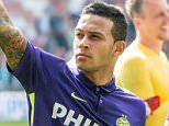 epa04741924 Eindhoven player Memphis Depay thanks the supporters during the Dutch Eredivisie soccer match between PSV Eindhoven and Heracles Almelo in Eindhoven, The Netherlands, 10 May 2015. Memphis Depay plays his last home match as he will be playing for Manchester United next season.  EPA/Ronald Bonestroo