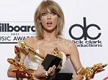 """Taylor Swift poses in the press room with the awards for top Billboard 200 album for ì1989,"""" top female artist, chart achievement, top artist, top Billboard 200 artist, top hot 100 artist, top digital song artist, and top streaming song (video) for ìShake It Offî at the Billboard Music Awards at the MGM Grand Garden Arena on Sunday, May 17, 2015, in Las Vegas. (Photo by Eric Jamison/Invision/AP)"""