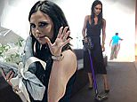 Victoria Beckham waves to photographers as she walks off the runway after presenting her Fall/Winter 2015 collection during the Singapore Fashion Week, Sunday, May 17, 2015, in Singapore. (AP Photo/Wong Maye-E)