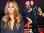 LAS VEGAS, NV - MAY 16:  Model Chrissy Teigen (L) and singer John Legend appear at 1 OAK Nightclub at The Mirage Hotel & Casino for a special Pre-Billboard Music Award celebration on May 16, 2015 in Las Vegas, Nevada.  (Photo by David Becker/WireImage)