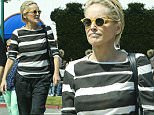 UK CLIENTS MUST CREDIT: AKM-GSI ONLY\nEXCLUSIVE: Actress Sharon Stone hangs out with a friend while enjoying a beautiful sunny day in Pacific Palisades, CA.\n\nPictured: Sharon Stone\nRef: SPL1028440  160515   EXCLUSIVE\nPicture by: AKM-GSI / Splash News\n\n