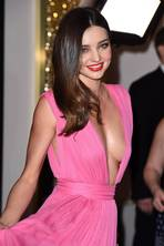 Pretty in pink: Miranda Kerr turns heads in revealing gown at Magnum party in Cannes