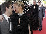 Jury members Xavier Dolan, left, and Sienna Miller pose for photographers upon arrival for the screening of the film Carol at the 68th international film festival, Cannes, southern France, Sunday, May 17, 2015. (AP Photo/Thibault Camus)