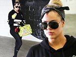 Khloe Kardashian carried her custom painted HermËs Birkin bag with her as she left he gym.  The black-clad reality star still managed to have her hands full, with her oversized keychain and sports-bottle, on Monday, May 18, 2015  X17online.com