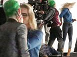 137367, EXCLUSIVE: Jared Leto is seen in full costume as The Joker for the first time with Margot Robbie as Harley Quinn on the set of 'Suicide Squad' in Toronto. In the scene, The Joker stops his car before hitting Harley Quinn. She yells at him to get out and they argue and share a kiss. A trucker gets out with a crow bar and Harley shoots him and then turns the gun on The Joker. The Joker takes the gun, and then slaps her down to the ground. The Joker was driving a custom Pink sports car that had the license plate 'HAHAHA'. CANADA OUT Photograph: © PacificCoastNews. Los Angeles Office: +1 310.822.0419 sales@pacificcoastnews.com FEE MUST BE AGREED PRIOR TO USAGE