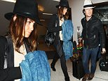 """EXCLUSIVE: Ian Somerhalder & Nikki Reed arrive in Los Angeles only weeks after getting married and  reports that Nikki Reed wants to become a mother """"at some point"""".  The adorable newlyweds were seen at LAX wearing fedoras and pulling their own luggage. \n\nPictured: Ian Somerhalder, Nikki Reed\nRef: SPL1028643  160515   EXCLUSIVE\nPicture by: Splash News\n\nSplash News and Pictures\nLos Angeles: 310-821-2666\nNew York: 212-619-2666\nLondon: 870-934-2666\nphotodesk@splashnews.com\n"""