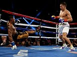 Boxer Gennady Golovkin (R) from Kazakhstan knocks down Willie Monroe of the US in the second round before finally knocking him out in the sixth round during their Middleweight World Championship bout at the Forum Arena in Los Angeles, California on May 16, 2015.          AFP PHOTO / MARK RALSTONMARK RALSTON/AFP/Getty Images