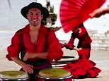 Santi Cazorla beats the bongo drums during his performance at the 'Goonervision Song Contest'