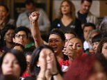 Workers react as the Los Angeles City Council votes to raise the minimum wage in the city to $15 an hour by 2020, making it the largest city in the nation to do so, in Los Angeles Tuesday, May 19, 2015. The measure approved Tuesday calls for small businesses with 25 or fewer employees to have an additional year to reach the $15 plateau. The council voted 14-1 after members of the public made impassioned statements for and against the plan. The increases begin with a wage of $10.50 in July 2016, followed by annual increases to $12, $13.25, $14.25 and then $15. Small businesses and nonprofits would be a year behind. (AP Photo/Damian Dovarganes )