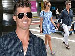 19.MAY.2015 - NICE - FRANCE *AVAILABLE FOR UK SALE ONLY* POP STAR ROBIN THICKE ARRIVES AT NICE AIRPORT WITH HIS NEW YOUNG GIRLFRIEND APRIL LOVE GEARY FOR THE 68TH CANNES FILM FESTIVAL.   BYLINE MUST READ : XPOSUREPHOTOS.COM ***UK CLIENTS - PICTURES CONTAINING CHILDREN PLEASE PIXELATE FACE PRIOR TO PUBLICATION *** **UK CLIENTS MUST CALL PRIOR TO TV OR ONLINE USAGE PLEASE TELEPHONE  44 208 344 2007 ***