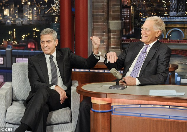 No leaving:George Clooney took the matter into his own hands on the Late Show on Thursday nightto stop David Letterman from retiring