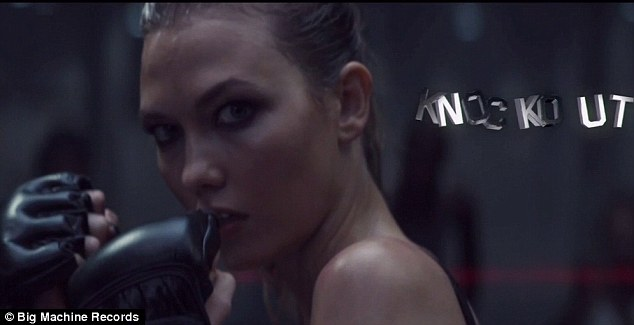 Ready to fight: Karlie Kloss stars as Knockout and puts up her fists as she confronts Taylor