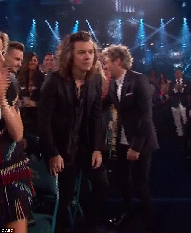 Hilarious: While Harry walked off with a smile on his face, Niall burst into laughter
